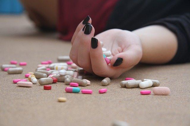 a hand full of pills